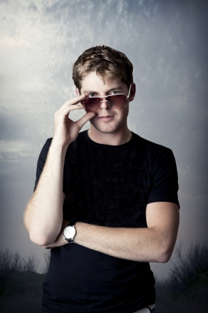 Fashion portrait of young man in fashionable sun glasses Stock Photo - 13790714