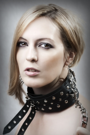 beautiful bdsm: Sexy woman with chain and collar Stock Photo