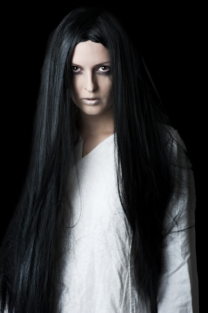 Young brunette woman with long black hair photo