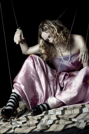 Young woman with beauty hair. Marionette concept photo