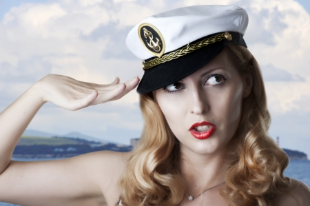 sailor hat: Portrait of sexy pin up female model in navy clothes
