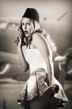 pin up girl: Portrait of pin up girl about vintage aircraft in retro style Stock Photo