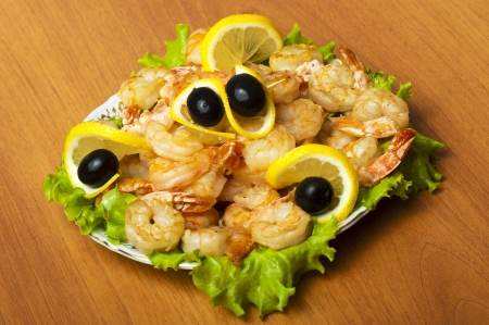 fried shrimp on white plate in restaurant - Mediterranean cuisine photo