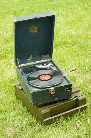 phonograph: Vintage Russian Soviet Red army green gramophone of times of the second world war on grass outside Editorial