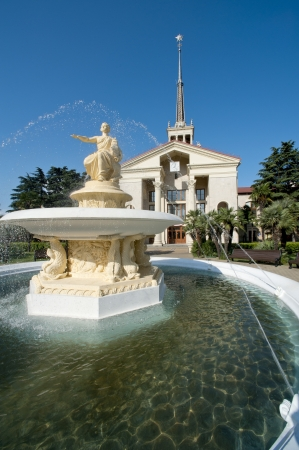 sea port: Fountain about Commercial Sea Port of Sochi (Russia), and beautiful tropical garden with palm trees Stock Photo