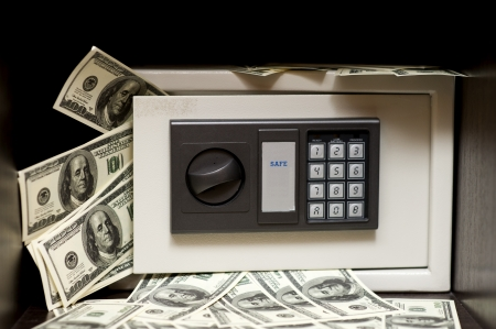 Little steel electronic safe with money (100 dollars banknotes). bank safe with the digital lock  Stock Photo - 14309305