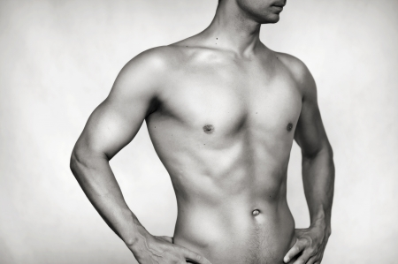 Sexy bared male body - torso, press, hip and waist photo