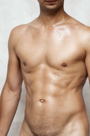 Nude wet muscular torso of unknown man  Stock Photo