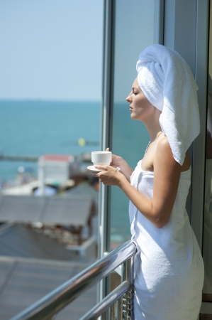 Young woman drink coffe on a hotel balcony Stock Photo - 14349695