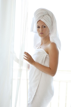 overexposed: overexposed light portrait of young woman in white towels about window