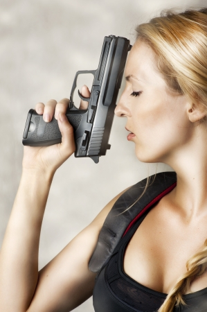 Young sexy blond Woman With Handgun Stock Photo - 14379218