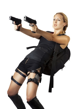 Sexy beautiful dangerous woman shooting from two hand guns Stock Photo - 14426057