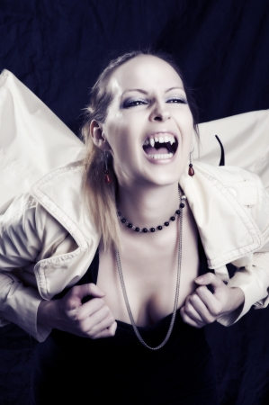 Beauty young woman screaming portrait - vampire style for halloween photo