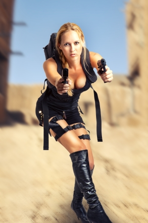 Sexy beautiful dangerous woman holding two hand gun