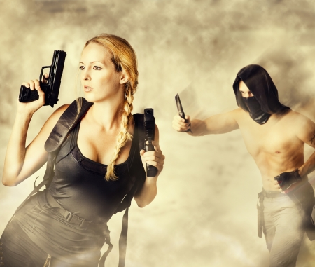man holding gun: Male Assassin with a knife Attacks Woman Warrior holding two pistols in her hands