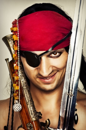 Close up portrait of sexy handsome male pirate photo