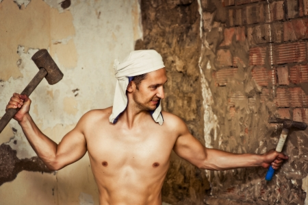 Handsome young sexy topless construction worker with sledge hammer Stock Photo - 14715589
