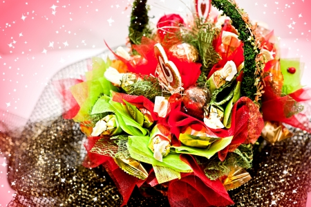Bouquet of sweets - candy in a basket photo