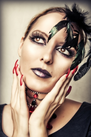 human fingernail: Fashion portrait of sexy female vampire with gothic make up and long red nails