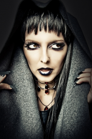 Halloween style - costume and make up of sexy evil witch Stock Photo - 14996576