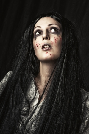 scary girl: Portrait of a gory bloody and scary zombie