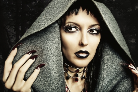 beautiful vampire: Halloween style - costume and make up of sexy evil witch