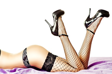 Sexy female buttocks and legs in high heel black shoes and stockings photo
