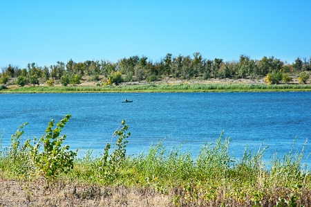 the volga river: Beautiful view of river with fisher on a boat
