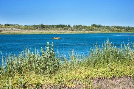 Beautiful view of river with fisher on a boat Stock Photo - 15482546