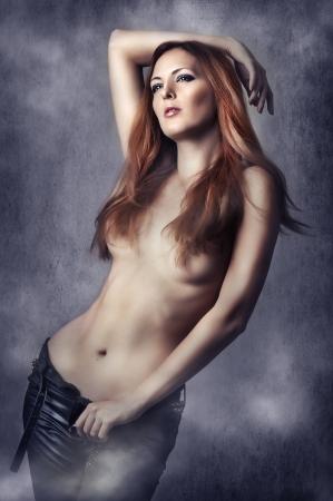 breast pocket: Fashion portrait of Sexy brunette woman in black pants