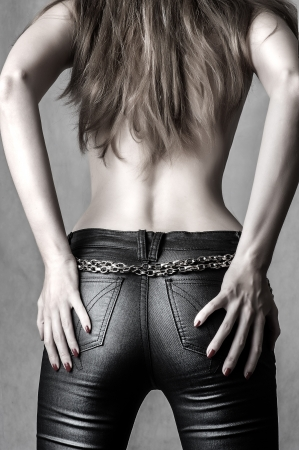 hands on waist: sexy female model wearing a pair of sexy pants