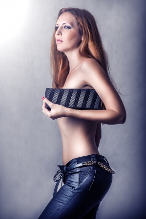 tight fit: Fashion sexy woman in black pants holding clutch handbag Stock Photo