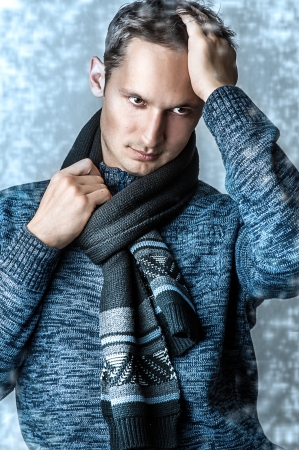 men hairstyle: Young fashion casual man in scarf and blue sweater Stock Photo