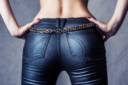 women in jeans: sexy female model wearing a pair of sexy pants