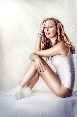Young sexy beautiful woman in white cotton lingerie, socks, wristwatch and bracelets photo
