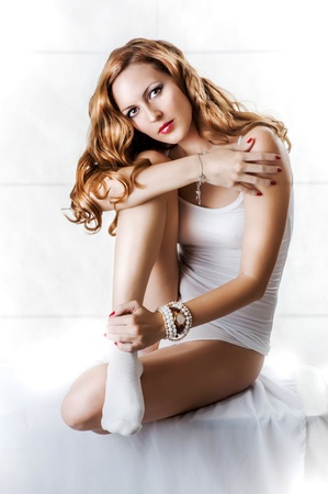 long socks: Young sexy beautiful woman in white cotton lingerie, socks, wristwatch and bracelets