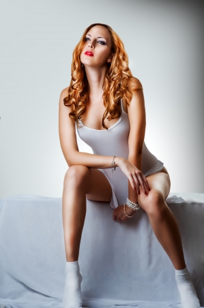 long socks: Young sexy beautiful woman in white cotton lingerie, socks  and bracelets