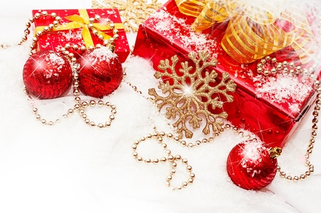 composition - Red and gold Christmas gifts and decorations on a white snow Stock Photo - 16279926