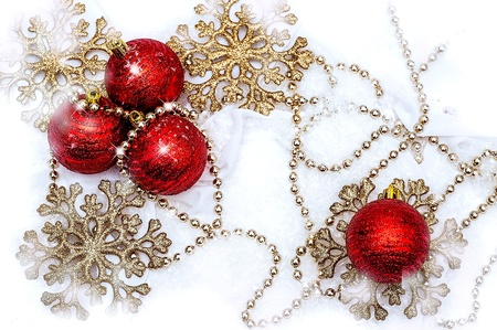 composition - Red and gold Christmas decorations on a white snow Stock Photo - 16279928