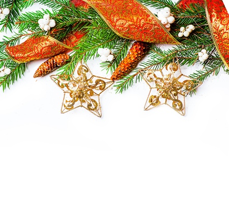 Christmas Decorations border over white - stars, berry, con on fir tree branch Stock Photo - 16279934