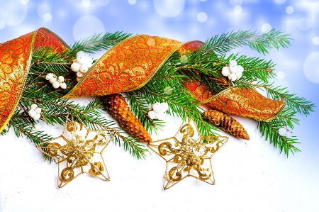 Christmas Decorations - stars, ribbon, con on fir tree branch Stock Photo - 16279933