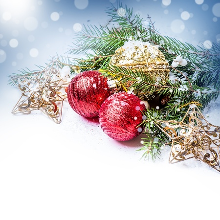 composition - Red and gold Christmas decorations - balls; stars on a fir tree branch Stock Photo - 16279940