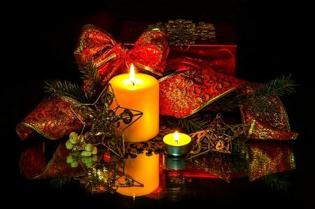 Christmas Decorations background - beads; star, two candles on fir tree branch photo