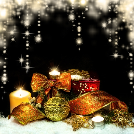 Christmas Decorations background - ribbon; ball, tree candles on fir tree branch photo
