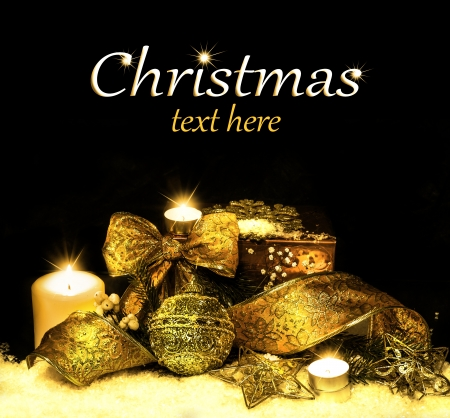Christmas Decorations background - ribbon; ball, tree candles on fir tree branch Stock Photo