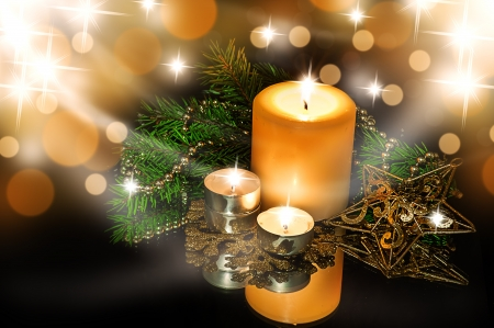 Christmas Decorations background - beads; star, tree candles on fir tree branch Stock Photo - 16392189