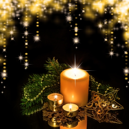 Christmas Decorations background - beads; star, tree candles on fir tree branch photo