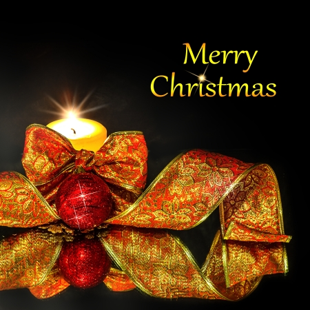 Christmas Decorations background with candle and ribbon on a black mirror