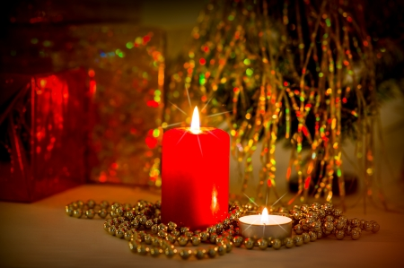 Christmas evening background. Two candles and decorations photo