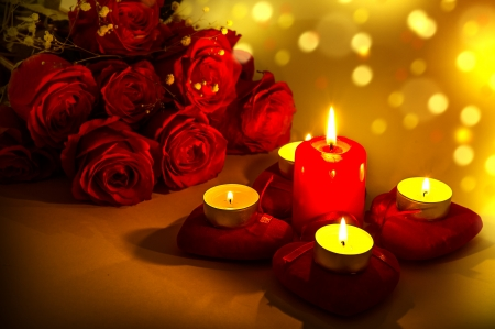 Romantic background for valentines day with candles and red hearts photo